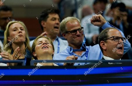Mirka Federer reacts in the players box as she watches the quarterfinal between Roger Federer of Switzerland and Grigor Dimitrov of Bulgaria in the Arthur Ashe Stadium