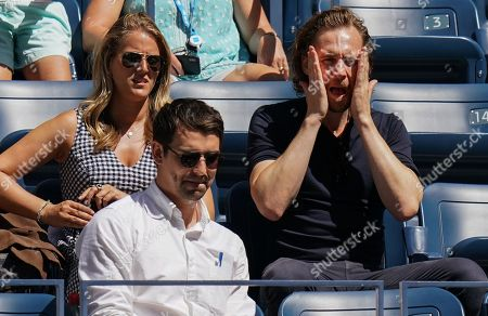 Tom Hiddleston reacts in the player's box of Johanna Konta as he watches Johanna Konta of Great Britain play against Elina Svitolina of Ukraine in the quarterfinal in the Arthur Ashe Stadium