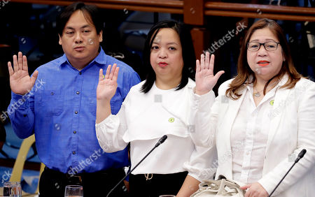 """Allan Antonio Sanchez, Ave Marie Tonee Sanchez, Elvira Sanchez. The family of convicted former Mayor Antonio Sanchez, from left, son Allan Antonio Sanchez, daughter Ave Marie Tonee Sanchez and wife Elvira Sanchez, take their oaths during the second straight day of the Senate probe in the failed attempt to release from prison the former Mayor, convicted in the rape and murders of two students in 1993 in suburban Pasay city south of Manila, Philippines. Calls are mounting for the Bureau of Corrections Chief Nicanor Faeldon's resignation after his office allegedly permitted the release of nearly 2,000 convicted heinous criminals whose actions are not covered by the """"Good Conduct Time Allowance"""" law"""