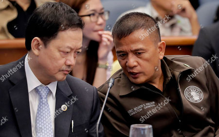 """Nicanor Faeldon, Menardo Guevarra. Nicanor Faeldon, right, the Director General of the Bureau of Corrections, talks to Justice Secretary Menardo Guevarra as they testify for the second straight day on the Senate probe in the failed attempt to release from prison former Mayor Antonio Sanchez who was convicted in the rape and murders of two students in 1993 in suburban Pasay city south of Manila, Philippines. Calls are mounting for Faeldon's resignation after his office allegedly permitted the release of nearly 2,000 convicted heinous criminals whose actions are not covered by the """"Good Conduct Time Allowance"""" law"""