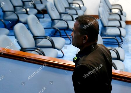"""Nicanor Faeldon, the Director General of the Bureau of Corrections leaves the Senate floor at the adjournment of the Senate probe in the failed attempt to release from prison former Mayor Antonio Sanchez who was convicted in the rape and murders of two students in 1993 in suburban Pasay city south of Manila, Philippines. Calls are mounting for Faeldon's resignation after his office allegedly permitted the release of nearly 2,000 convicted heinous criminals whose actions are not covered by the """"Good Conduct Time Allowance"""" law"""
