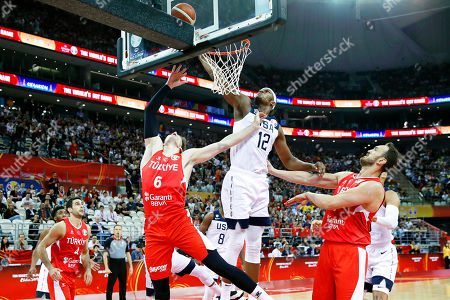 Myles Turner (C) of the USA in action against Cedi Osman (R) of Turkey during the FIBA Basketball World Cup 2019 group E first ?round? match between the USA and Turkey in Shanghai, China, 03 September 2019.