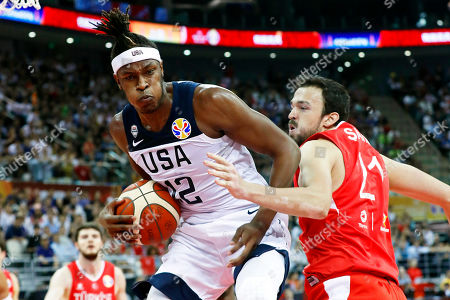 Myles Turner (L) of the USA in action against Sertac Sanli (R) of Turkey during the FIBA Basketball World Cup 2019 group E first ?round? match between the USA and Turkey in Shanghai, China, 03 September 2019.