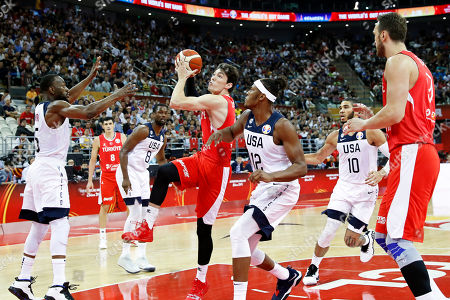 Myles Turner (C-R) of the USA in action against Cedi Osman (C-L) of Turkey during the FIBA Basketball World Cup 2019 group E first ?round? match between the USA and Turkey in Shanghai, China, 03 September 2019.