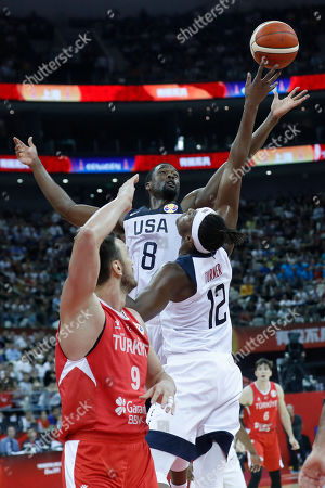 Harrison Barnes of USA (C) and Myles Turner of USA (R) in action against Semih Erden of Turkey during the FIBA Basketball World Cup 2019 group E first ?round? match between the USA and Turkey in Shanghai, China, 03 September 2019.