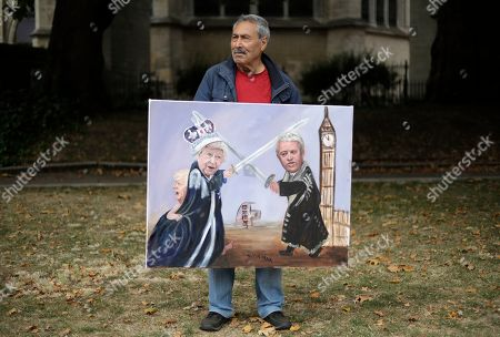 Political artist Kaya Mar holds his painting of British Prime Minister Boris Johnson, left, Britain's Queen Elizabeth II, center, and Speaker of the House of Commons John Bercow as he stands opposite Parliament Square in London, . Opposition parties are challenging British Prime Minister Boris Johnson's insistence that the U.K. will leave the EU on Oct. 31, 2019 even without a deal, setting up a pivotal day in British politics