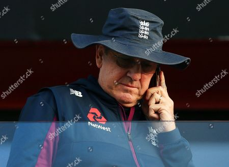 England head coach Trevor Bayliss on his mobile phone at the end of the game