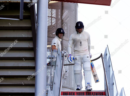 Stock Picture of Jason Roy and Joe Denly of England make their way out to bat ahead of the game