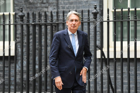 Conservative Party lawmaker and former Chancellor, Philip Hammond, leaves Downing Street in London