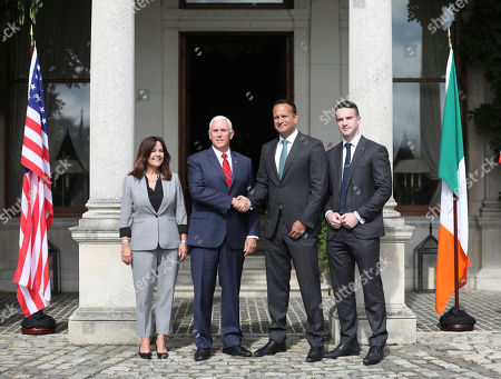 US Vice President Mike Pence and wife Karen Pence, left, meet with the Irish Prime Minister Leo Varadkar and his partner Matt Barrett, right, at Farmleigh House, Dublin, Ireland, . The Vice President is currently in Ireland for a two day visit