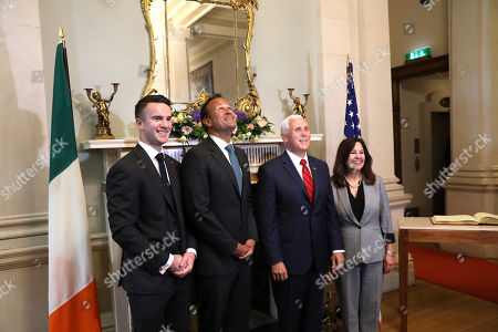 US Vice President Mike Pence and wife Karen Pence, right, meet with the Irish Prime Minister Leo Varadkar and his partner Matt Barrett, left as they look at a chandelier at Farmleigh House, Dublin, Ireland, . The Vice President is currently in Ireland for a two day visit