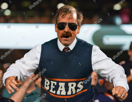 Chicago Bears fan impersonating former Chicago Bears Head Coach Mike Ditka in the stands