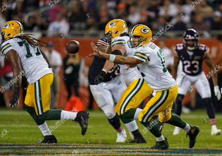 Stock Photo of Aaron Rogers, Quarterback of the Green Bay Packers (12), throws the ball