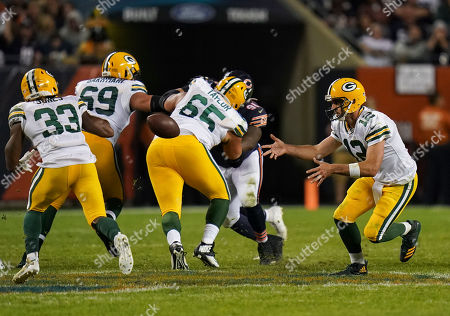 Stock Picture of Aaron Rogers, Quarterback of Green Bay Packers (12), throws the ball to Aaron Jones, Running Back of Green Bay Packers (33)