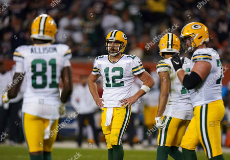 Aaron Rogers, Quarterback of Green Bay Packers (12), reacts during play