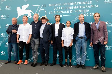 Udo Kier, Aleksey Kravchenko, Stellan Skarsgard, Barry Pepper, Petr Kotlar, Vaclav Marhoul, Julian Sands. Actors Udo Kier, from left, Aleksei Kravchenko, Stellan Skarsgard, Barry Pepper, from fourth right Petr Kotlar, director Vaclav Marhoul and Julian Sands pose for photographers at the photo call for the film 'The Painted Bird' at the 76th edition of the Venice Film Festival in Venice, Italy