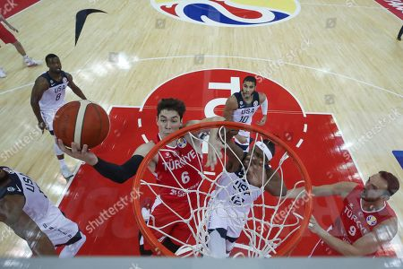 Cedi Osman (L) of Turkey and Myles Turner (C) of USA in action during the FIBA Basketball World Cup 2019 group E first round match between the USA and Turkey in Shanghai, China, 03 September 2019.