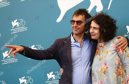 Atom Egoyan, Arsinee Khanjian. Director Atom Egoyan, left, and actress Arsinee Khanjian pose for photographers at the photo call for the film 'Guest of Honour' at the 76th edition of the Venice Film Festival in Venice, Italy