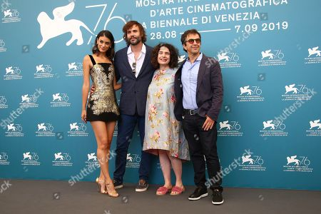 Stock Picture of Atom Egoyan, Arsinee Khanjian, Rossif Sutherland, Laysla De Oliveira. Director Atom Egoyan, from right, actors Arsinee Khanjian, Rossif Sutherland and Laysla De Oliveira pose for photographers at the photo call for the film 'Guest of Honour' at the 76th edition of the Venice Film Festival in Venice, Italy