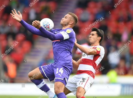 Carlton Morris of Rotherham United and Reece James of Doncaster Rovers