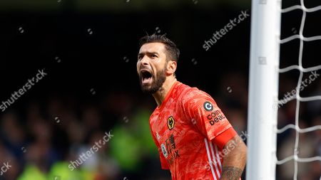 Wolverhampton Wanderers' goalkeeper Rui Patricio shouts during the English Premier League soccer match between Everton and Wolverhampton Wanderers at Goodison Park in Liverpool, England