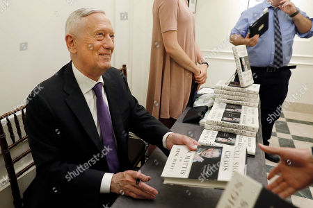 Former U.S. Secretary of Defense Jim Mattis signs copies of his book after he spoke at the Council on Foreign Relations, in New York