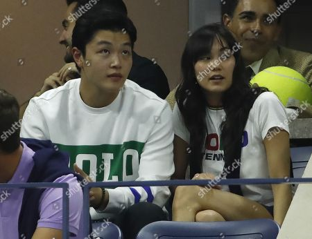 Stock Photo of US figure skaters Maia and Alex Shibutani watch Grigor Dimitrov of Bulgaria play Roger Federer of Switzerland during their quarter-finals round match on the ninth day of the US Open Tennis Championships the USTA National Tennis Center in Flushing Meadows, New York, USA, 03 September 2019. The US Open runs from 26 August through 08 September.