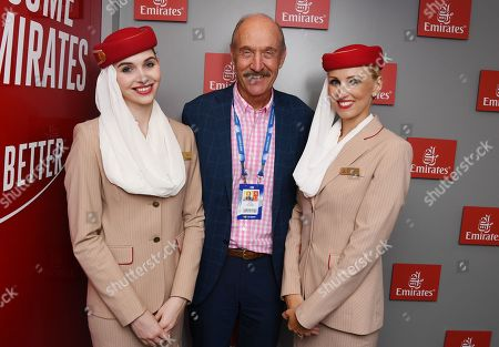 Stan Smith and Emirates Airlines Cabin Crew members