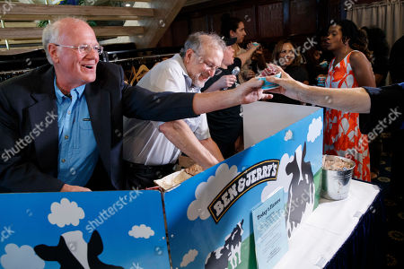 Ben Cohen (L) and Jerry Greenfield (R), Co-Founders of Ben & Jerry's serve ice cream including the company's newest flavor Justice ReMix'd during a press conference in the National Press Building in Washington, DC, USA, 03 September 2019. This flavor launch is part of Ben & Jerry's partnership with Advancement Project National Office to fight for justice for all, despite race or wealth.