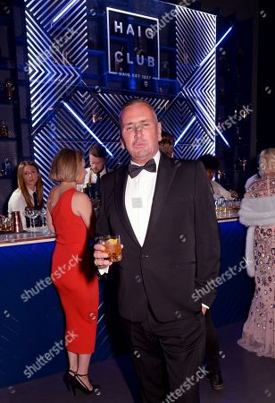 Fat Tony enjoys Haig Club cocktails at the GQ Men Of The Year Awards 2019 at the Tate Modern in London.