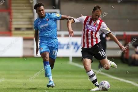 Stock Picture of Tahvon Campbell and Gary Warren   during the EFL Trophy match between Exeter City and Cheltenham Town at St James' Park, Exeter