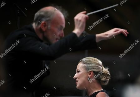 German operatic soprano, Diana Damrau (R) sings as Italian conductor Gianandrea Noseda (L) conducts The London Symphony Orchestra (LSO) as they perform Iain Bell 'The Hidden Place' - a song cycle for soprano and orchestra - during the George Enescu International Festival 2019, in Bucharest, Romania, 03 September 2019. The festival, held since 1958 every two years, is the biggest classical music festival held in Romania, in honor of Romanian composer and violinist George Enescu. The 24th edition of the George Enescu International Festival takes place between 31 August and 22 September 2019.