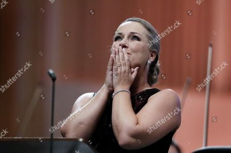 Stock Image of German operatic soprano, Diana Damrau, together with The London Symphony Orchestra (LSO), performs the Final Scene of Richard Strauss' opera 'Capriccio' during the George Enescu International Festival 2019, in Bucharest, Romania, 03 September 2019. The festival, held since 1958 every two years, is the biggest classical music festival held in Romania, in honor of Romanian composer and violinist George Enescu. The 24th edition of the George Enescu International Festival takes place between 31 August and 22 September 2019.