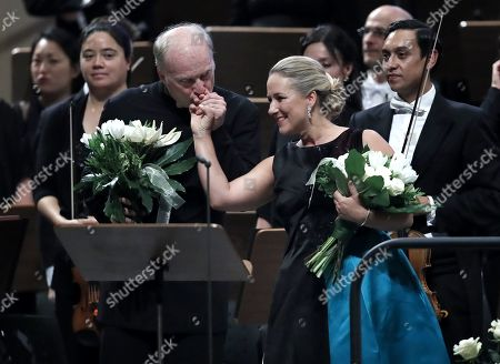 Italian conductor Gianandrea Noseda (L) kisses the hand of German operatic soprano Diana Damrau (R), backed by the members of London Symphony Orchestra, at the end of their concert during the George Enescu International Festival 2019, in Bucharest, Romania, 03 September 2019. The festival, held since 1958 every two years, is the biggest classical music festival held in Romania, in honor of Romanian composer and violinist George Enescu. The 24th edition of the George Enescu International Festival takes place between 31 August and 22 September 2019.