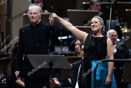 Stock Picture of Italian conductor Gianandrea Noseda (L) and German operatic soprano Diana Damrau (R), backed by the members of London Symphony Orchestra, greet the audience at the end of their concert during the George Enescu International Festival 2019, in Bucharest, Romania, 03 September 2019. The festival, held since 1958 every two years, is the biggest classical music festival held in Romania, in honor of Romanian composer and violinist George Enescu. The 24th edition of the George Enescu International Festival takes place between 31 August and 22 September 2019.