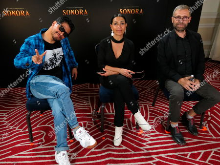 """Actors Harold Torres, left, Dolores Heredia and Juan Manuel Bernal, right, of the Mexican film """"Sonora"""" pose during an interview in Mexico City. """"Sonora"""", a film about a perilous journey in the Mexican desert, premieres on Sept. 6 in Mexico"""