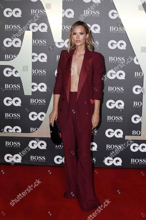 Charlotte de Carle poses for photographers on arrival at the GQ Men of the year Awards in central London on