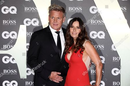 Chef Gordon Ramsay and partner Tana Ramsay pose for photographers on arrival at the GQ Men of the year Awards in central London on