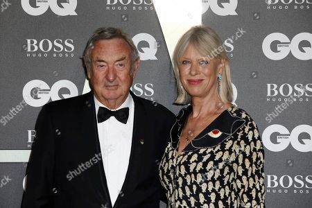 Nick Mason and his wife Nettie Mason pose for photographers on arrival at the GQ Men of the year Awards in central London on