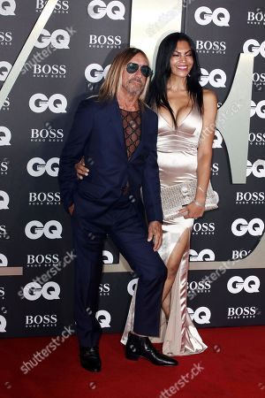 Iggy Pop and partner Nina Alu pose for photographers on arrival at the GQ Men of the year Awards in central London on