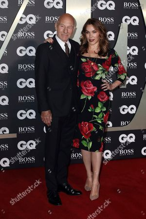 Stock Image of Sir Patrick Stewart and his wife Sunny Ozell pose for photographers on arrival at the GQ Men of the year Awards in central London on