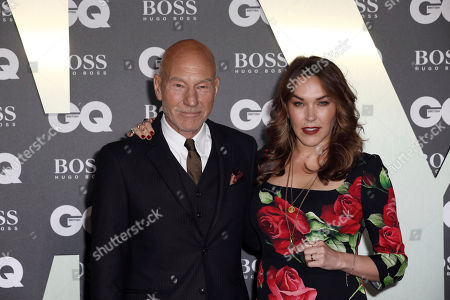 Stock Photo of Sir Patrick Stewart and his wife Sunny Ozell pose for photographers on arrival at the GQ Men of the year Awards in central London on
