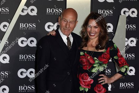 Sir Patrick Stewart and his wife Sunny Ozell pose for photographers on arrival at the GQ Men of the year Awards in central London on