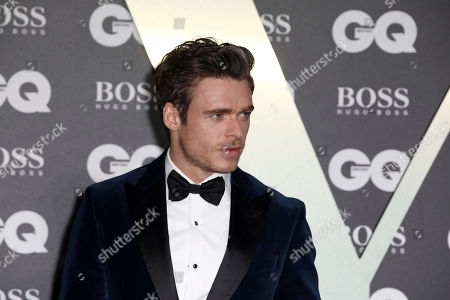 Richard Madden poses for photographers on arrival at the GQ Men of the year Awards in central London on