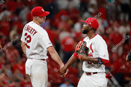 St. Louis Cardinals' Jack Flaherty, left, and Dexter Fowler celebrate a 1-0 victory over the San Francisco Giants in a baseball game, in St. Louis