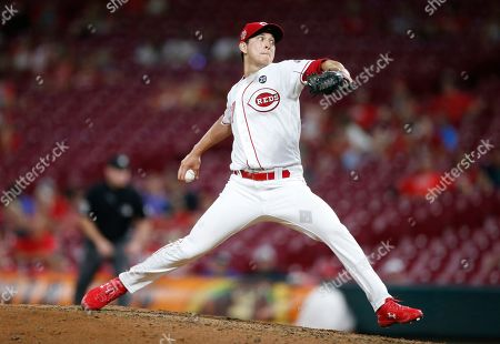 Stock Image of Cincinnati Reds relief pitcher Matt Bowman (67) throws against the Philadelphia Phillies during the eighth inning of a baseball game, in Cincinnati