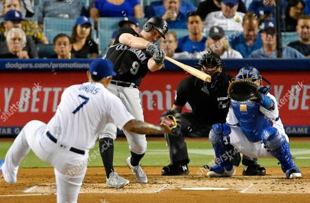 Daniel Murphy, Julio Urias, Russell Martin, Dan Bellino. Colorado Rockies' Daniel Murphy hits a solo home run off Los Angeles Dodgers starting pitcher Julio Urias, left, as catcher Russell Martin watches during the second inning of a baseball game, in Los Angeles