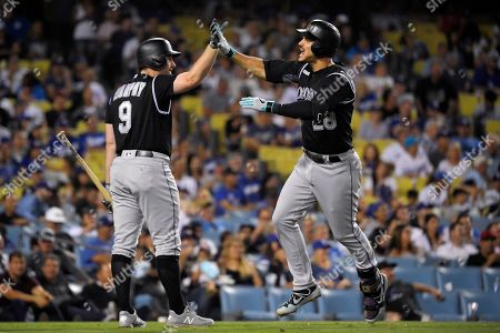 Nolan Arenado, Daniel Murphy. Colorado Rockies' Nolan Arenado, right, celebrates with Daniel Murphy after hitting a solo home run during the fourth inning of the team's baseball game against the Los Angeles Dodgers, in Los Angeles