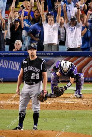 Stock Picture of Bryan Shaw, Tony Wolters. Colorado Rockies relief pitcher Bryan Shaw, left, watches a ball hit by Los Angeles Dodgers' David Freese go out for a solo home run as catcher Tony Wolters kneels at the plate during the seventh inning of a baseball game, in Los Angeles