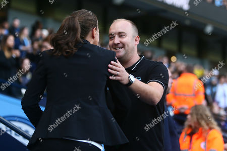 Manchester City Women manager, Nick Cushing greets Casey Stoney, manager of Manchester United